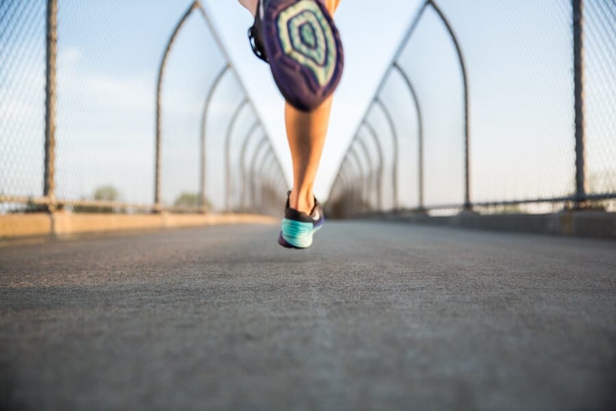 Person running on a bridge