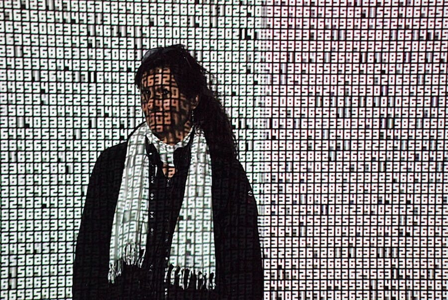 Woman covered in numbers
