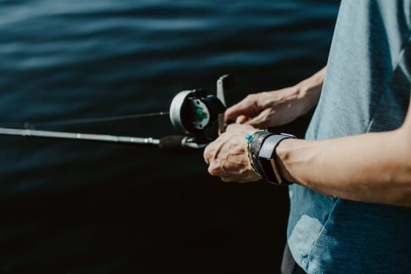 Man fishing with fitbit
