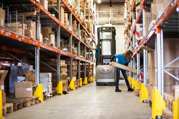 Woman stocking warehouse