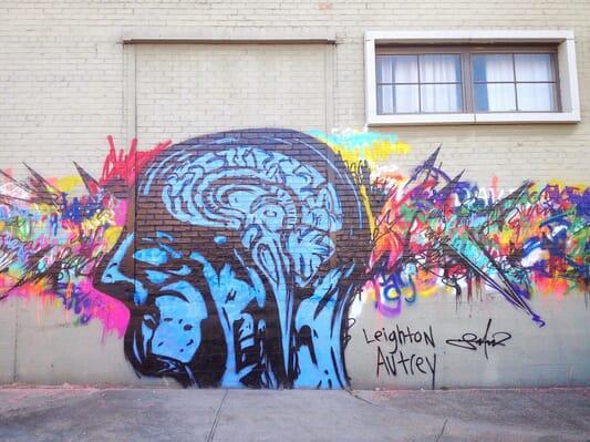 Wall graffiti of brain in chaos